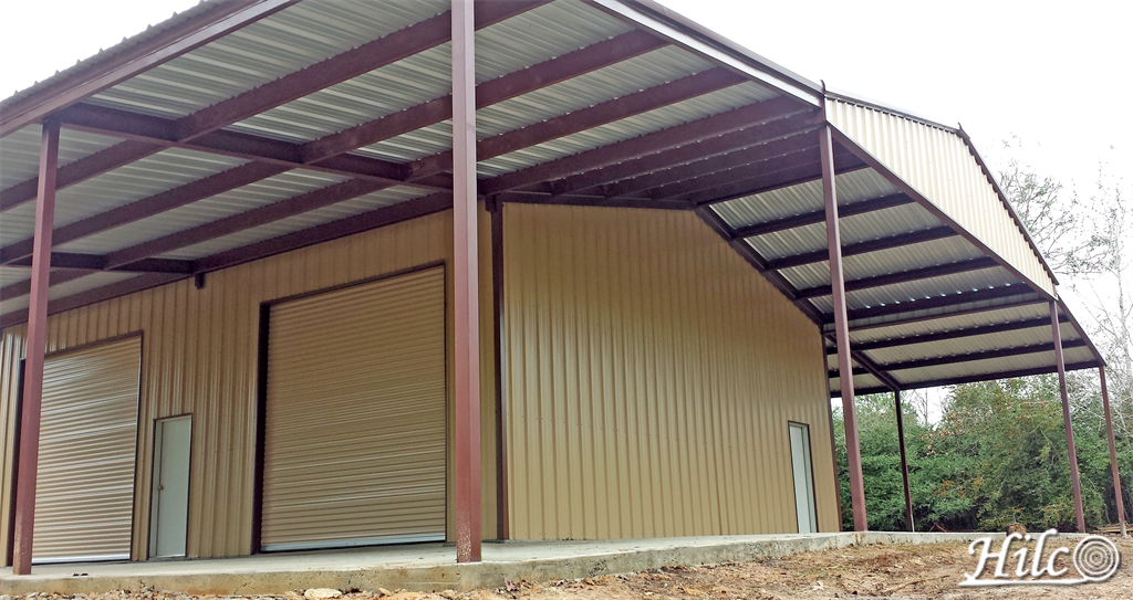 Barndominium with large roll-up garage doors