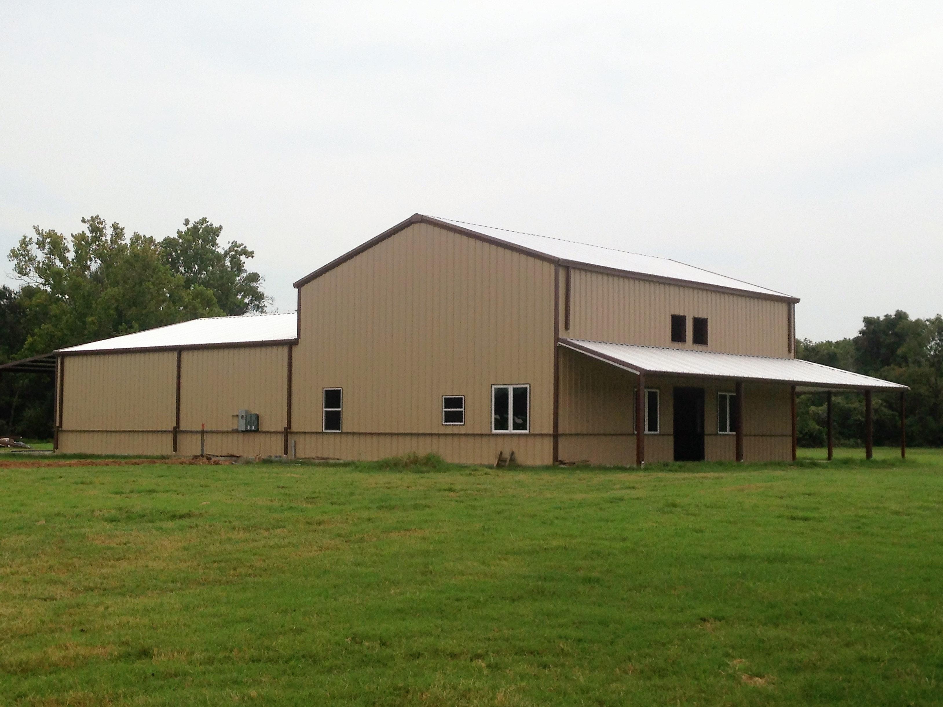 Completed Multi-Height Metal Building with Covered Porch